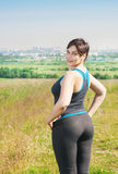 Fitness plus size woman outdoor Royalty Free Stock Photo