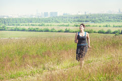 Fitness plus size woman running outdoor Stock Photo