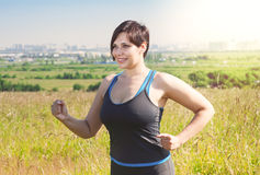 Fitness plus size woman running outdoor Royalty Free Stock Images