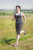 Fitness plus size woman running outdoor royalty free stock photo