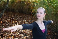 Fitness portrait. Young blond caucasian woman participating in a yoga exercises in the garden Stock Images