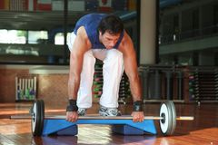 Fitness & Power Men With Yoke. Exercise of a men in training with the balance / Looking Below / Above the Step royalty free stock photo