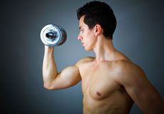 Fitness - powerful muscular man. Lifting weights Stock Photo