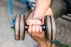 Fitness  powerful muscular man lifting weights. In the park Stock Photo