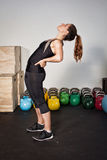Fitness preparation - streching exercise. In a gym Royalty Free Stock Photography