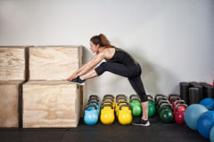 Fitness preparation - streching exercise. In a gym Stock Photo