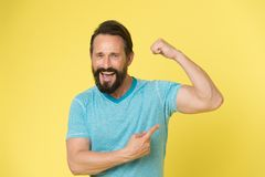 Fitness result. man show on muscle as result after fitness training. fitness result of happy man. man pointing on biceps. Showing fitness result. workout royalty free stock photos
