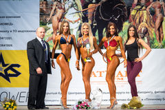 Fitness. Reutov, Russia - April 02, 2016: Winners of the competition in women's fitness bikini on a Cup of Moscow Region on bodybuilding, fitness and bodyfitness Stock Photos