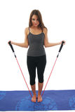 Fitness Routine. A woman exercising with a resistance rope Stock Photography