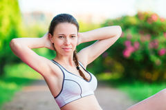 Fitness runner body doing warm-up routine in the park before running, stretching leg muscles with standing single knee Royalty Free Stock Photos