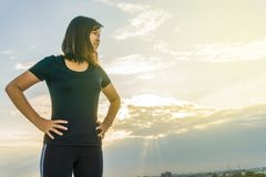 Fitness runner body doing warm-up routine on roof top building b. Fitness runner body closeup doing warm-up routine on roof top building before running, cardio Royalty Free Stock Image