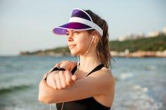 Fitness runner doing warm-up routine on beach before running Stock Photo