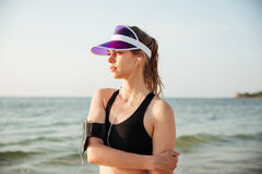 Fitness runner doing warm-up routine on beach before running Stock Photos