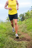 Fitness runner jogging in running shoes outdoors Stock Image