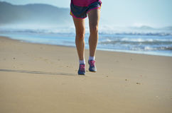 Fitness and running on beach, woman runner working out on sand near sea, healthy lifestyle and sport Stock Photo