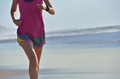 Fitness and running on beach, woman runner working out on sand near sea, healthy lifestyle and sport Stock Photos
