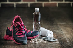 Fitness running sports equipment, sneakers water phone music tow. El on wooden floor, healthy lifestyle Royalty Free Stock Photos