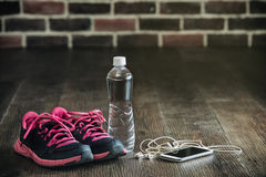Fitness running sports equipment, sneakers water phone music, he. Fitness running sports equipment, sneakers water phone music on wooden floor, healthy lifestyle stock image