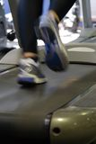 Fitness,running on the treadmill. The photo is taken indoors under florescent light with no flash Stock Photography
