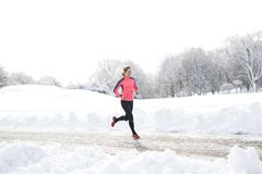 Fitness running woman in winter season. A Fitness running woman in winter season Stock Image