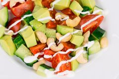 Fitness salad with avocado and tomatoes. Royalty Free Stock Images