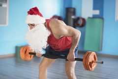 Fitness Santa Claus training with weights Royalty Free Stock Image