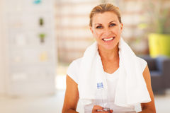 Fitness senior woman. With towel and water bottle Stock Photo