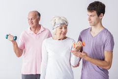 Fitness seniors exercising with trainer Royalty Free Stock Photo