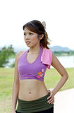 Fitness series accessories. An asian lady posing with a pink towel used to wipe sweat during exercise Stock Photos