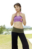 Fitness series accessories. An asian lady posing with a pink towel hanged around the neck used to wipe sweat during exercise Stock Photo