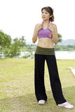 Fitness series accessories. An asian lady posing with a pink towel hanged around the neck used to wipe sweat during exercise Stock Photography