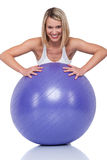 Fitness series - Blond woman with purple ball Stock Image