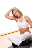 Fitness series - Blond woman stretching Royalty Free Stock Image