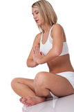 Fitness series - Blond woman in yoga position Royalty Free Stock Photography
