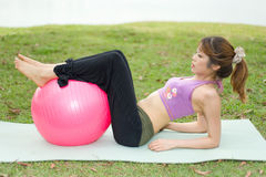Fitness series exercise ball. An asian female exercising with an exercise ball Stock Images