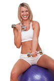 Fitness series - Smiling blond woman exercising. Smiling blond woman exercising with weights on white background Stock Images