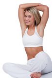 Fitness series - Smiling blond woman stretching Royalty Free Stock Photo