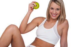 Fitness series - Smiling woman with green apple Royalty Free Stock Images