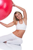Fitness series - Smiling woman with red ball Stock Photography