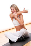 Fitness series - Smiling woman stretching Royalty Free Stock Photos