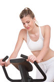 Fitness series - Sportive woman cycling royalty free stock photo