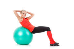 Fitness series: woman and exercise ball Royalty Free Stock Image