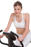 Fitness series - Woman on exercise bike Royalty Free Stock Photos