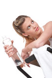 Fitness series - Woman with exercise bike. And bottle of water on white background Stock Image