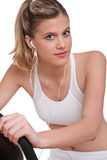 Fitness series - Woman with headphones exercising Stock Photos