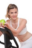 Fitness series - Woman holding apple stock photography