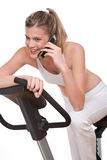 Fitness series - Woman with mobile phone Royalty Free Stock Photo