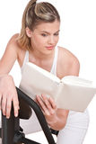 Fitness series - Woman reading book Royalty Free Stock Photos