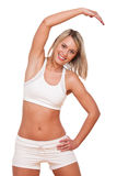 Fitness series - Young blond woman exercising Stock Photography