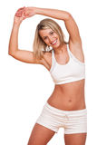 Fitness series - Young blond woman exercising. Young blond woman exercising on white background Stock Photo
